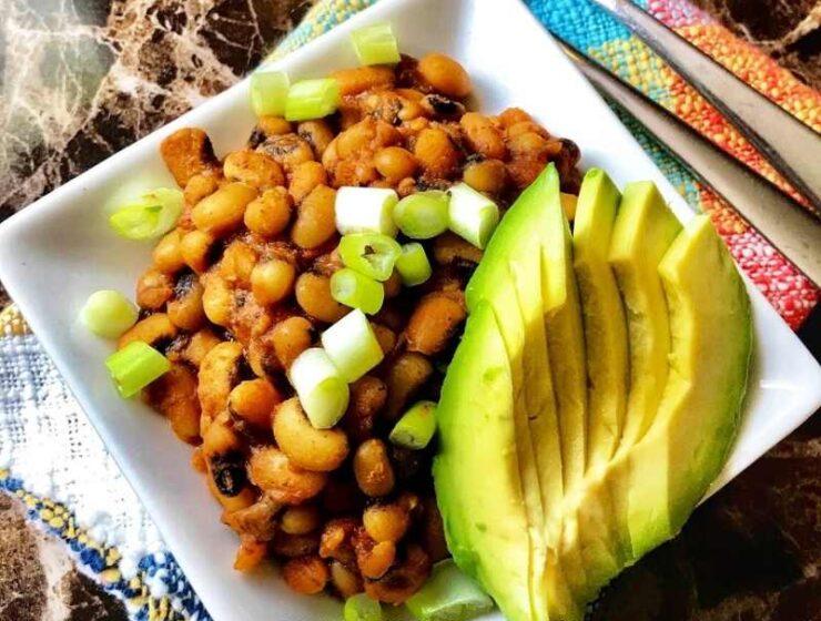 Super easy to make Nigerian beans recipe served with avocado