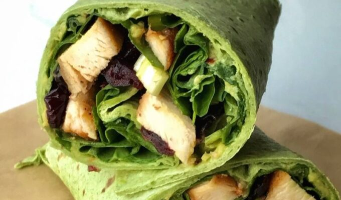 """Super easy to make healthy taco wrap recipe using a """"Garden Spinach Herb Wrap,"""" aka, the taco shell. Then filled up with well-seasoned and sautéed chicken breast, fresh spinach leaves, and spicy guacamole. Dry cranberries and green onions are optional, however necessary. This is the easiest healthy taco wrap recipe you will have to make, perfect for a quick lunch or busy weeknights. Taco recipe is adaptable, versatile, and easily customizable. Hope you enjoy!"""