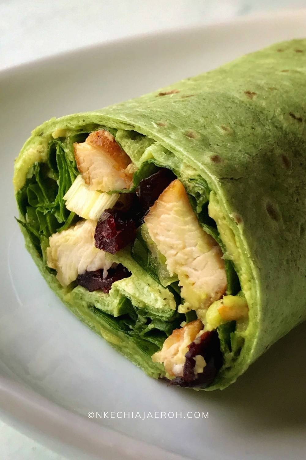 """Super easy to make healthy taco recipe comprising of """"Garden Spinach Herb Wrap,"""" aka, the taco shell. Then filled up with well-seasoned and sautéed chicken breast, fresh spinach leaves, and spicy guacamole. Dry cranberries and green onions are optional, however necessary. Typically taco sizes range from small hand-sized tortillas, like 8-inch to 12-inch corn or flour tortillas. Though taco originated in Mexico, it is very much acceptable in most parts of the world. Taco recipe is adaptable, versatile, and easily customizable.  #Taco #Tacorecipe #healthytaco #spinachwrap #Greentacowrap"""