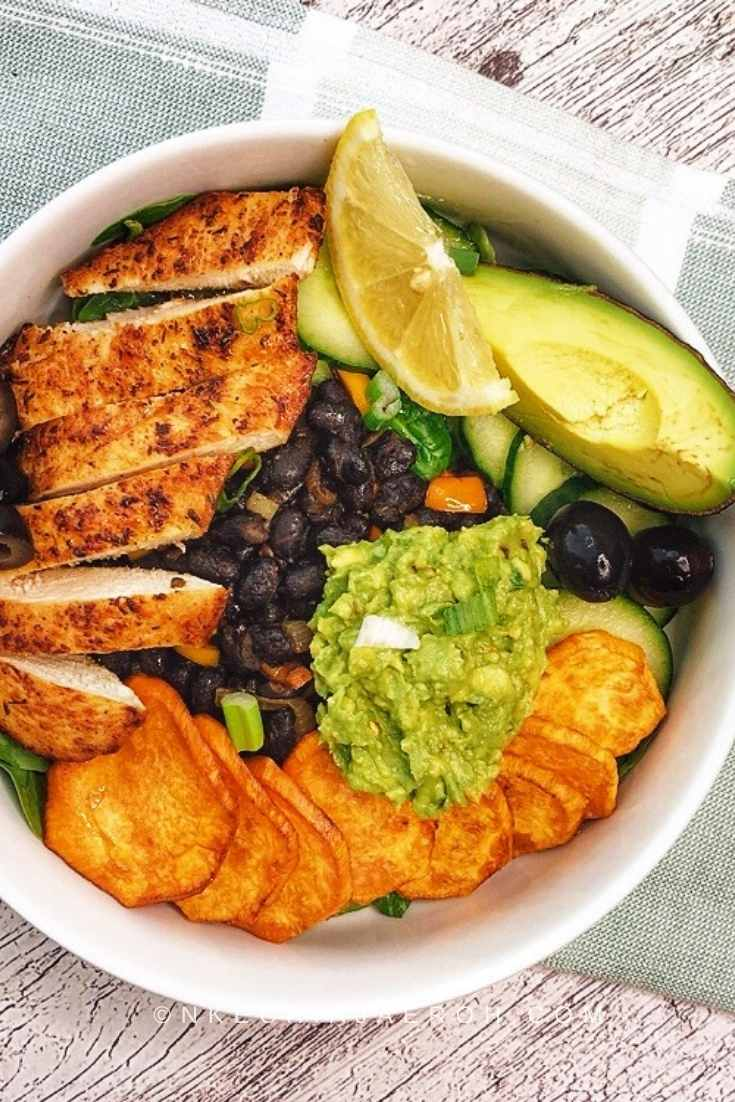 Deconstructed Taco Bowl Salad served with mashed avocado, olives, and vegetables