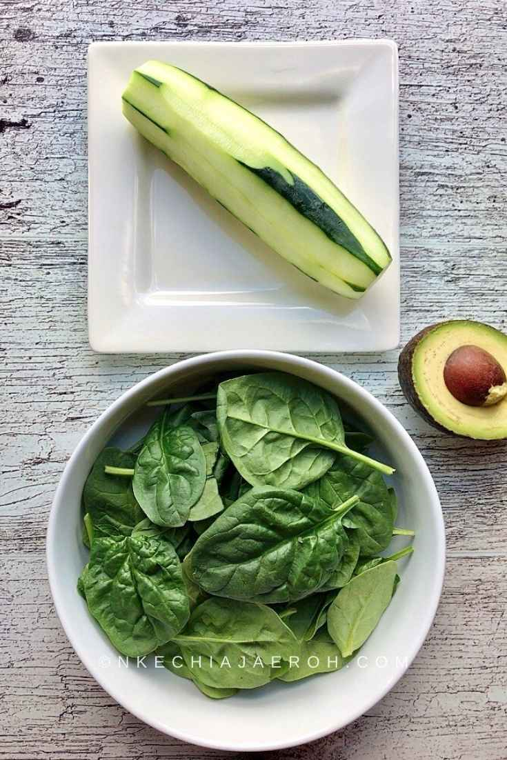 Raw spinach, cucumber, and avocado for The best Taco salad bowl recipe