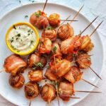 Small potatoes marinated in coconut cream parsley pesto wrapped in bacon and baked to perfection is literal heaven. These bacon wrapped small potatoes are tasty, flavorful, tender and soft inside, perfectly toasted, and crisp outside. Whether you are looking for your family's next best appetizer, or you are looking for that perfect dish to bring to the next potluck, these babies fit just right because they would please everyone! #Potatoes #Bacon #Baconwrappedpotatoes #appetizers #smallpotatoes