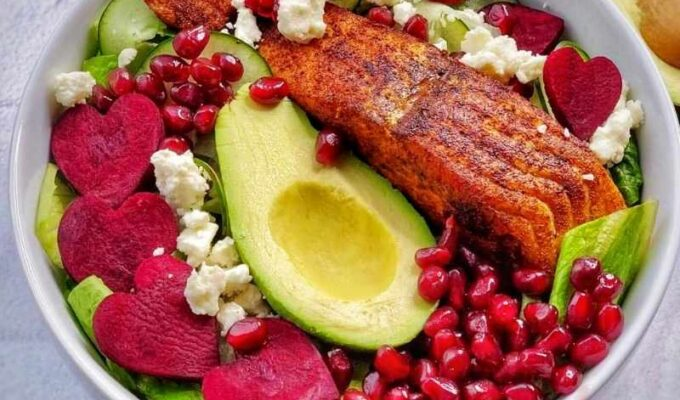 Easy to make raw beetroot and feta cheese salad with lettuce, cucumber, avocado, and salmon; serve with creamy yogurt dressing and top with your favorite things! I added pomegranate seeds, and it was perfect; the best part is that this recipe takes less than 15 minutes to put together. This heart-healthy beet salad is a dream!#Beet #beetroot #beetsalad #beetrootsalad #hearthealthysalad #beetsaladandfetacheese #beetrootandfetacheese #healthysaladrecipe