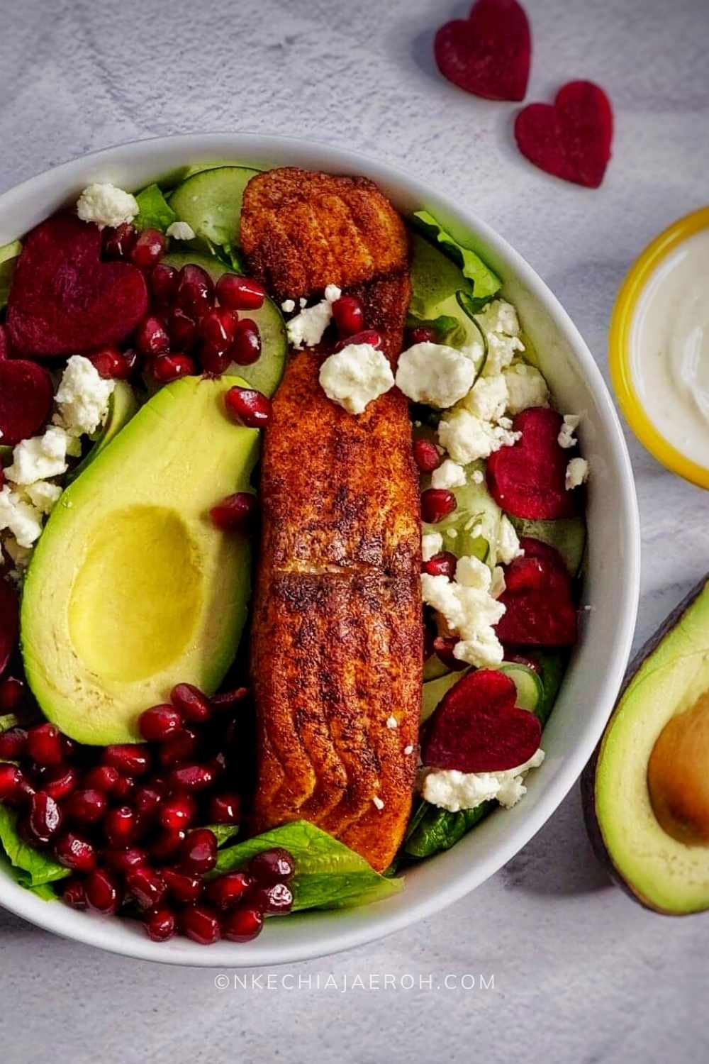 This salad is loaded with lettuce, cucumber, avocado, and salmon; serve with creamy yogurt dressing and top with your favorite things! I added pomegranate seeds, and it was perfect; the best part is that this recipe takes less than 15 minutes to put together.