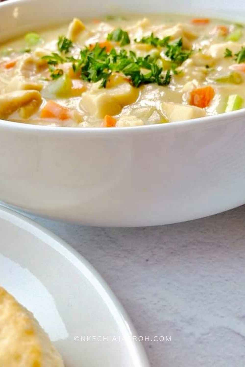 A perfect healthy chicken pot pie soup that is creamy, cozy, comforting, hearty, and very satisfying; this soup is gluten-free, dairy-free, nut-free, paleo-friendly, low-carb, and whole30-friendly. Serve this chicken pot pie soup with biscuits as we did, or crackers if you wish. This easy-to-make heart-healthy pot pie soup will keep you satisfied and wanting more at the same time!