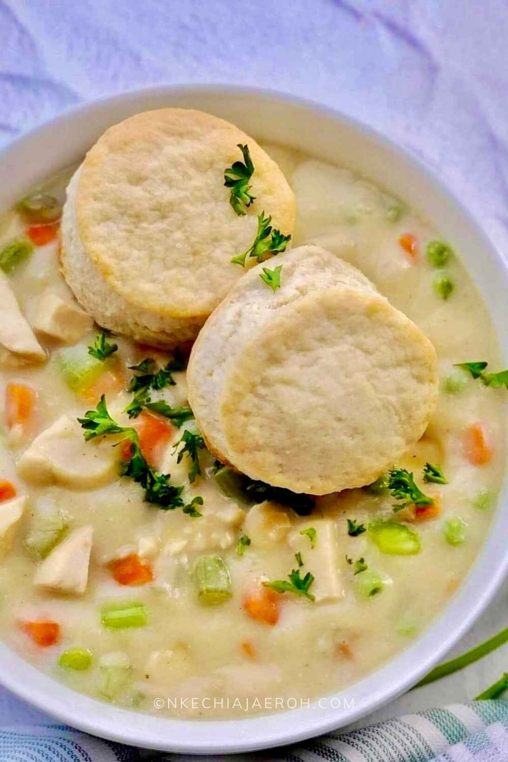 A perfect healthy chicken pot pie soup that is creamy, cozy, comforting, hearty, and very satisfying; this soup is gluten-free, dairy-free, nut-free, paleo-friendly, low-carb, and whole30-friendly. Serve this chicken pot pie soup with biscuits as we did, or crackers if you wish. This easy-to-make heart-healthy pot pie soup will keep you satisfied and wanting more at the same time! #Chickenrecipe #chickenpotpiesoup #Glutenfreerecipe #Dairyfreerecipe #Glutenfreechickenpotpiesoup #cauliflowerrecipe