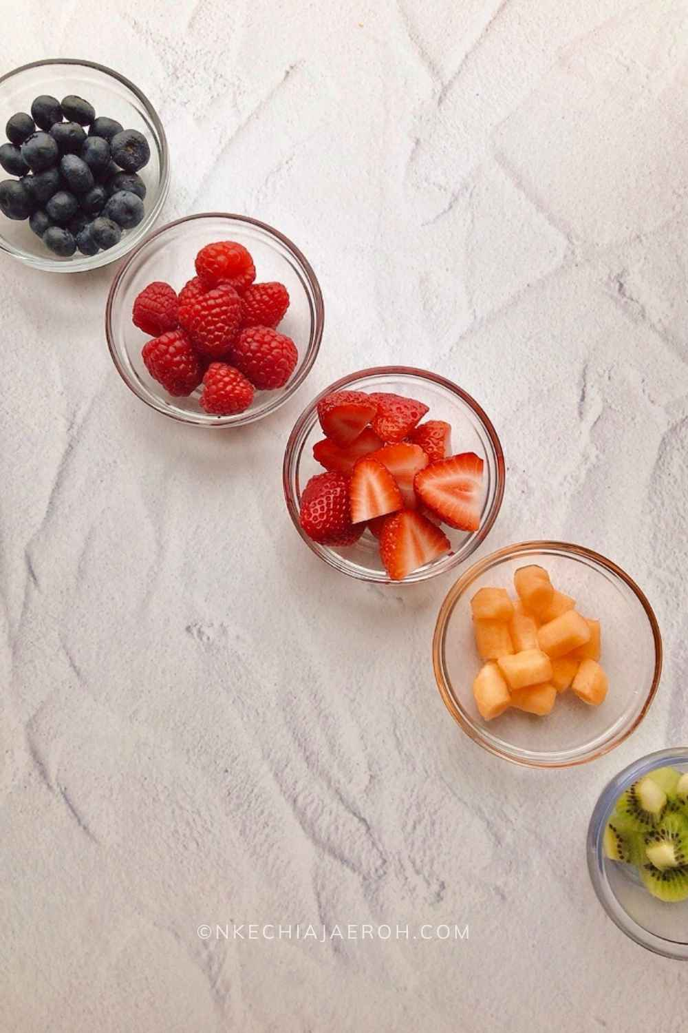 I used blueberries, strawberries, raspberries, kiwi (which is also a kind of berry), coconut water, and cantaloupe to make this fruit cereal. My love for melons knows no bound; I have some on hand and had to include it. There is nothing better than fresh coconut water; I have always felt that it tastes different from the store-bought coconut water. So I got a fresh coconut, cracked it open, and added the entire water to my nature's cereal bowl.