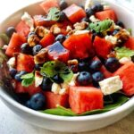 Healthy and fresh blueberry watermelon feta salad recipe with balsamic reduction is refreshingly sweet, savory, and easy to make! The best part about this recipe is that it comes together so fast and is equally cheap with readily available ingredients! This easy watermelon salad needs only four main ingredients – fresh watermelon, fresh blueberries, feta cheese, and fresh mint leaves. Look no further for an easy nutritious watermelon salad recipe for summer picnics or potlucks. This blueberry watermelon feta salad is equally excellent for Memorial Day or July 4th red, white and blue patriotic recipes!
