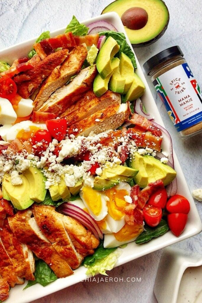 Keto cobb salad is low-calorie (low-carb, obviously), gluten-free, very tasty, and full of flavors. This salad is made with fresh romaine lettuce, sautéed chicken breast, crispy bacon, hard-boiled eggs, cherry tomatoes, avocado, and crumbled feta cheese. The best thing about this cobb salad is it can be prepped ahead, which means it comes together quickly whenever you want to eat it! This is the low-carb meal prep salad recipe you are looking for; easy, breezy, and tasty! Definitely a must-try! #Cobbsalad #Ketorecipe #ketocobbsalad #healthysalad #lowcarbsalad