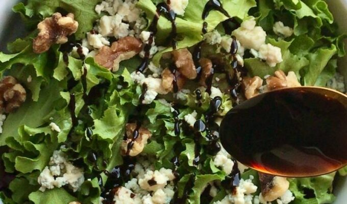 Easy to make and delightfully tasty vegetarian walnut blue cheese salad recipe requires only 4 ingredients. Walnuts, blue cheese, salad greens, and balsamic reduction! This 10-minute salad recipe is the perfect no-cook salad you need for the summer months and beyond! You can use this salad for lunch/dinner or as a side dish! Walnut blue cheese salad is a refreshingly light salad that is salty, sweet, and satisfying! Feel free to add your choice of protein for an enjoyable and comforting meal!