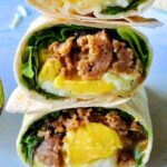 Homemade healthy freezer breakfast burritos are easy to make, tasty, and perfect for breakfast meal prep! These freezer breakfast burritos are packed with nutritious ingredients you will love, such as leafy greens, turkey sausage, eggs, and cheese! This will save you the hassle of figuring out what's for breakfast on busy mornings! Healthy freezer breakfast burritos will help you start your day right as well as keep you full, energized, and satisfied. #Breakfastburritos #Freezerfriendlyburritos #Freezermeals #healthyfreezerbreakfasts #makeaheadbreakfasts #Healthyfreezerbreakfastburritos