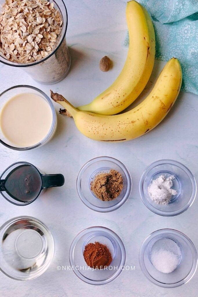 Ingredients for making this recipe includes ripe bananas, oats, plant based milk, cinnamon, nutmeg, salt, baking powder, maple syrup, and coconut oil