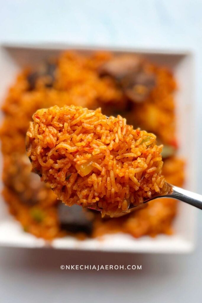 Insanely delicious party-style Nigerian basmati Jollof rice is the only Jollof rice recipe you need. The fusion of basmati rice with tomatoes, peppers, onions, garlic, curry, thyme, bay leaves, and other herbs/spices makes this party Jollof absolutely flavorful and tasty! The best part about making basmati Jollof rice is that it takes no time to cook. Amazingly, you can further cut down on this cooking time by making the sauce or base ahead of time. Call family and friends, let's gather for this authentic crowd-pleasing party-style Jollof rice recipe! #Jollofrice #Africanfood #Nigerianfood #PartyJollofrice #NigerianJollofrice #BasmatiJollofrice #Jollof